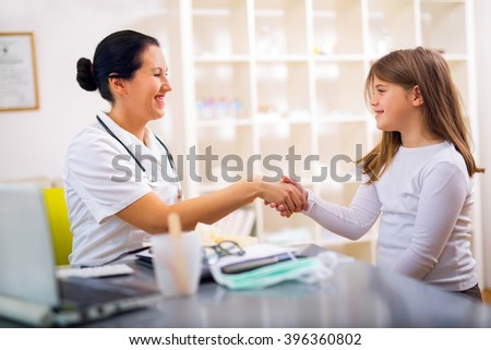 Female doctor and little girl patient. Medical examination. Selective focus - stock photo