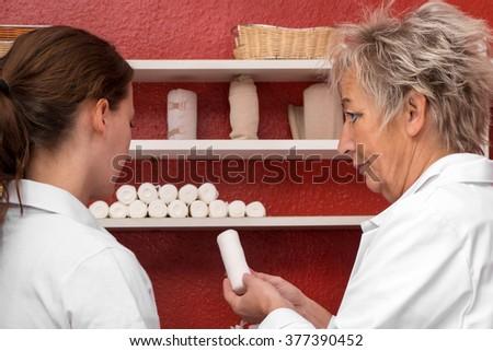 female doctor and student, doctor is explaining something - stock photo