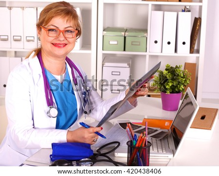 Female doctor at the desk in the office