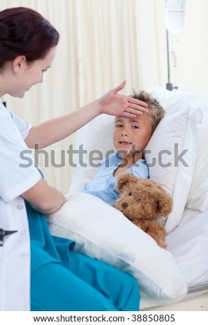 Female doctor examining  child fever in bed - stock photo