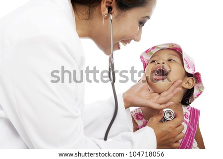 Female doctor examining cute little girl using stethoscope