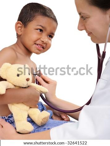 female doctor examining little child boy - stock photo