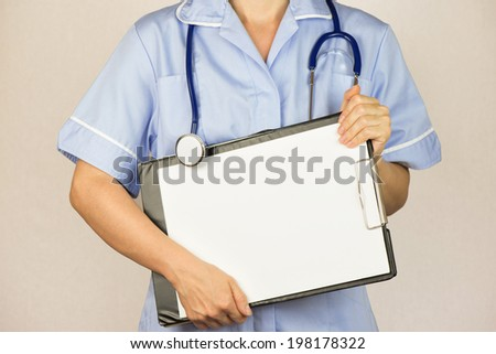 Female doctor holding a clipboard, isolated - stock photo