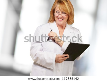 female doctor holding book, indoor