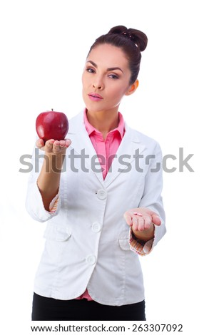 Female doctor holding green apple and bunch of tablets isolated on white background - stock photo
