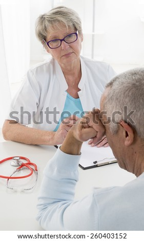 Female doctor listening to depressed male patient