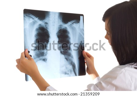 Female doctor looking at x-ray image on white - stock photo