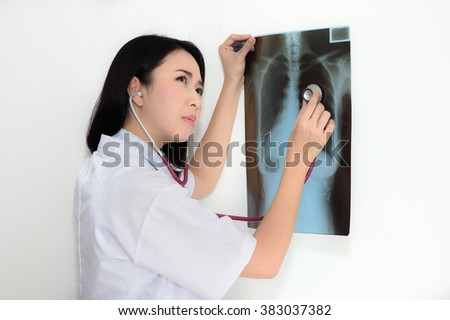 Female doctor physician holding up xrays looking perplexed. - stock photo