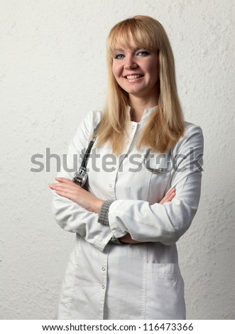 Female doctor smiling on the white background. - stock photo