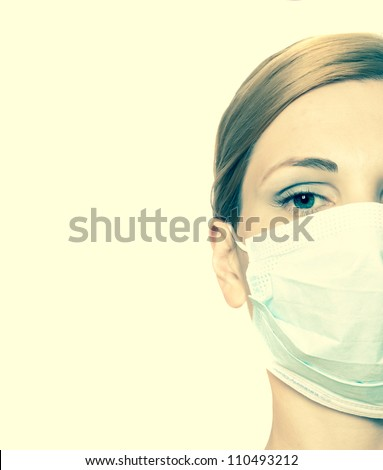 female doctor wearing surgical  mask - stock photo