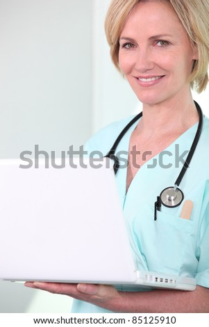 Female doctor with a laptop - stock photo