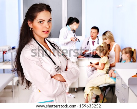 Female doctor with child in hospital. - stock photo