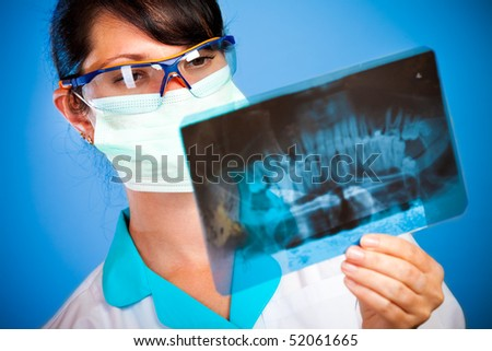 female doctor with jaw xray
