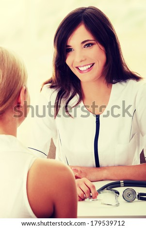 Female doctor with patient in office - stock photo