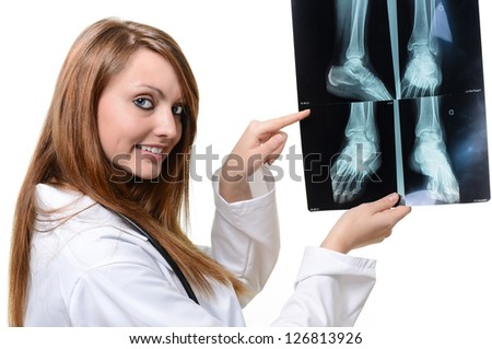 female doctor with x-ray in hand over a white background - stock photo