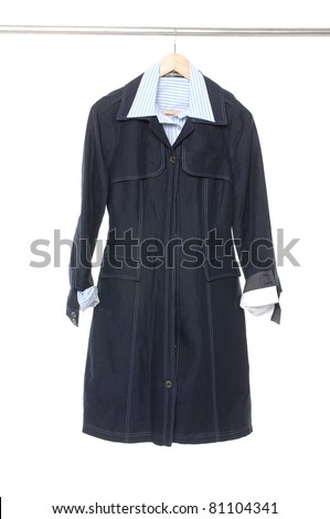 female dress isolated hanging on wooden hangers