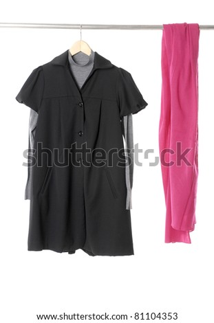 female dress with red scarf isolate on a wooden hanger ,studio isolated - stock photo