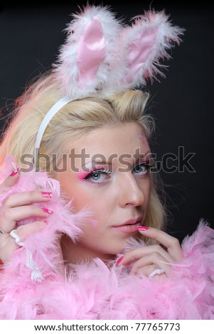 Female dressed up as rabbit cute girl in sexy playboy costume - stock photo