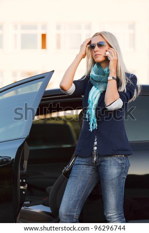 Female driver calling on the phone - stock photo