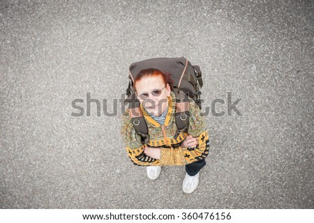 Female elderly tourist with backpack - stock photo
