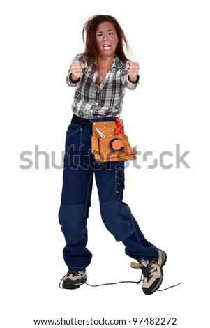 female electrician hit by the electric current - stock photo