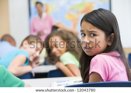 Female elementary school pupil being bullied - stock photo