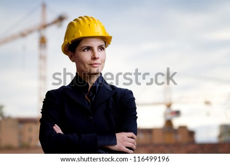 female engineer against building yard