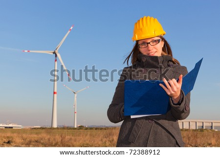 Female Engineer in Wind Turbine Power Generator Station - stock photo