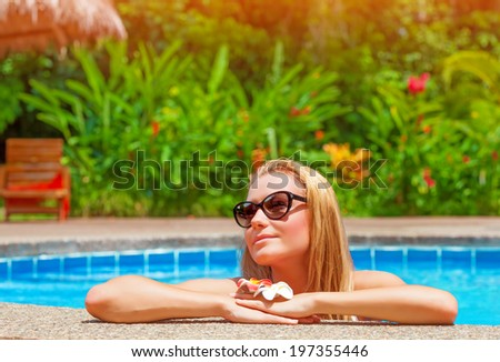 Female enjoying summer holidays, woman on day spa relaxation, sexy girl in the pool, luxury vacation on tropical resort, leisure and recreation concept - stock photo