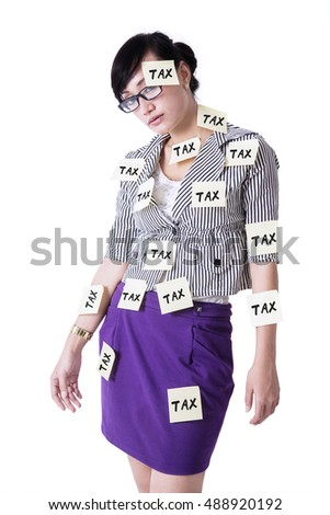 Female entrepreneur standing in the studio with tax reminders attached on her body