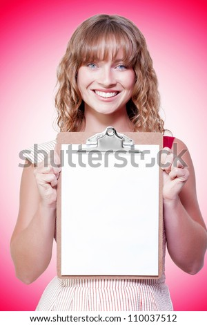 Female executive business person with smile holding clipboard in a copyspace conceptual on pink background - stock photo