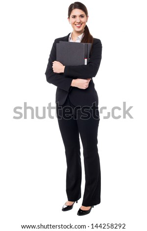 Female executive in formals holding files - stock photo