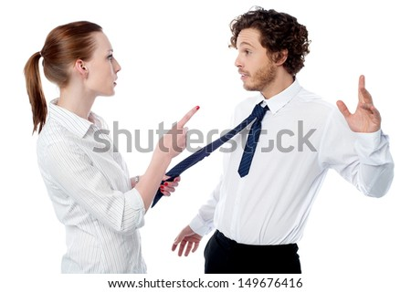 Female executive scolding her coworker - stock photo