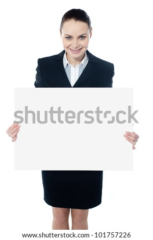 Female executive showing an empty billboard isolated over white