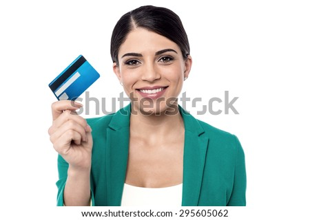 Female executive showing her new credit card. - stock photo