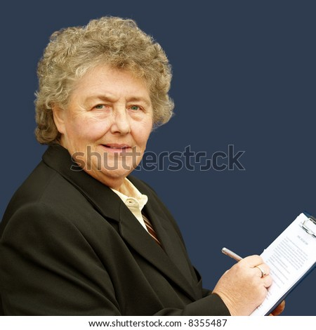 Female executive taking stock and making an inventory - stock photo