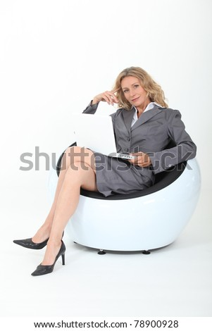 Female executive using a laptop - stock photo