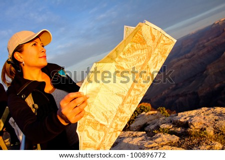 Female explorer with a map at the Grand Canyon - stock photo