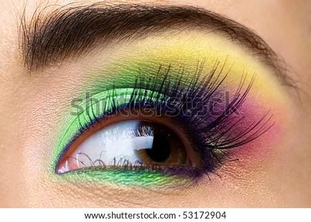 Female eye with colored make-up and long eyelashes - stock photo