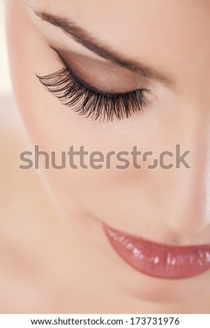 female eye with long false eyelashes - stock photo