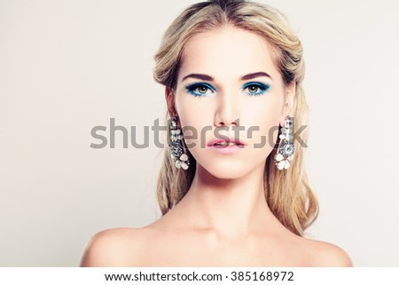 Female Face. Beautiful Fashion Model Woman with Blonde Hair - stock photo