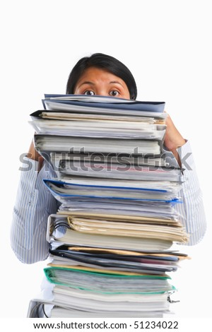 Female face behind pile of paper, the concept of heavy workload - stock photo