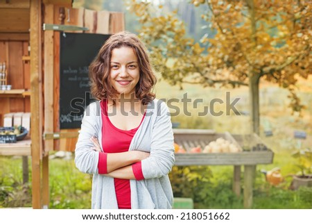 female farm shop owner - stock photo