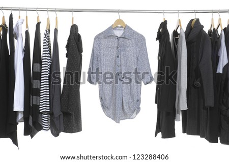 female fashion clothing on hangers at the show - stock photo