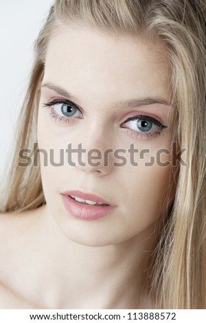 female fashion model head shot posing at light background - stock photo