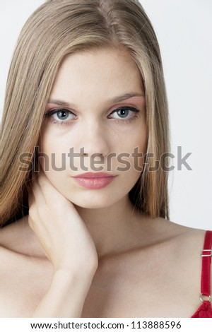female fashion model head shot posing at light background