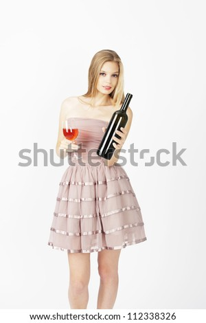 female fashion model posing at light grey background - stock photo