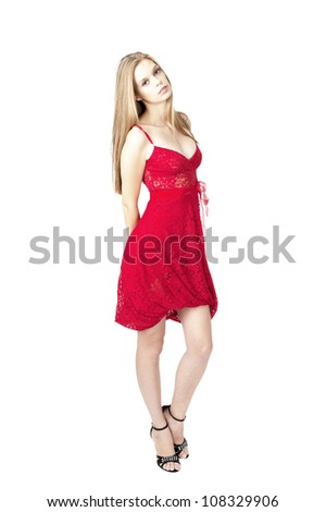 female fashion model posing at red dress at white background ,isolated