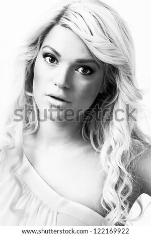 female fashion model,posing at white background,portrait,high key - stock photo