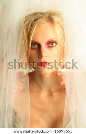 Female fashion model styled with dramatic makeup.